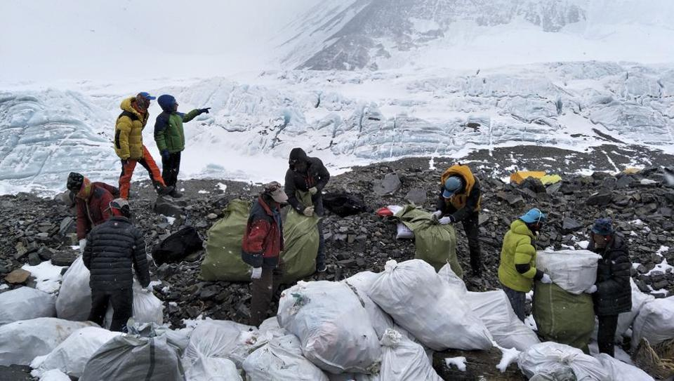 People collect garbage at the north slope of the Mount Qomolangma in southwest China's Tibet Autonomous Region.