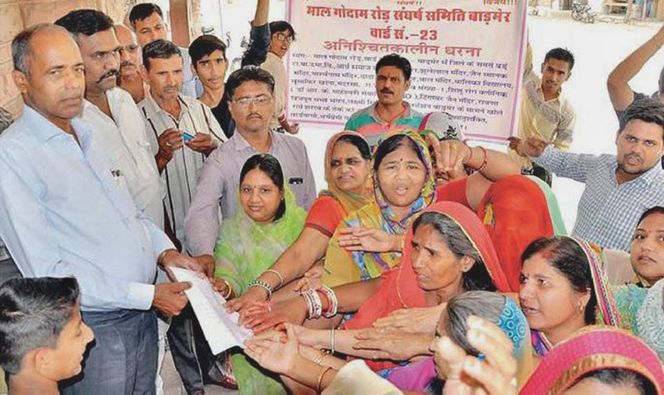 Citizens protest against a liquor shop near a girls school in Barmer in Rajasthan.