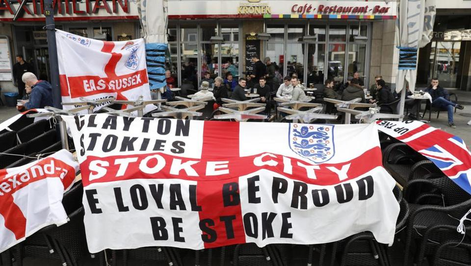 England fans display banners in Dortmund before their team's friendly match against