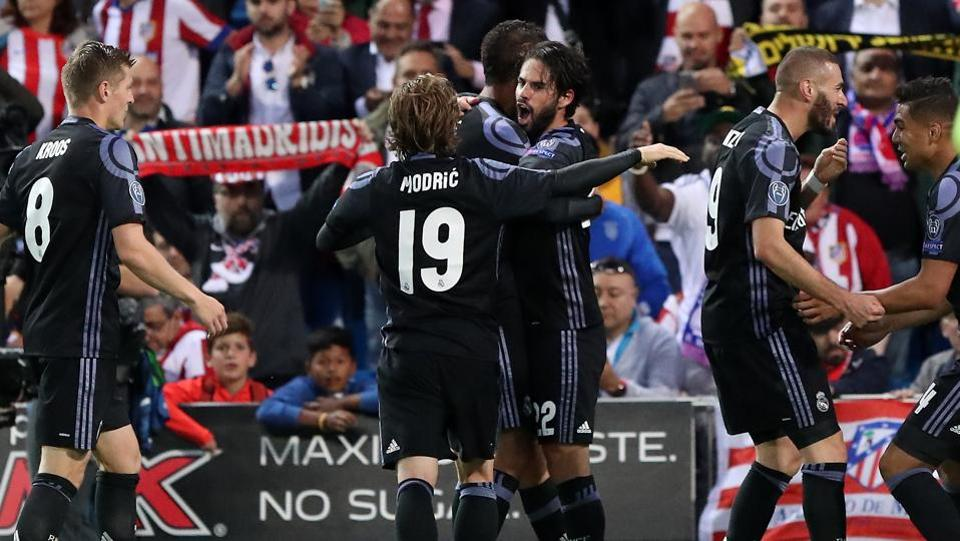 Real Madrid players celebrate midfielder Isco's goal (C) during the UEFA Champions League semifinal second leg match against Atletico Madrid at the Vicente Calderon stadium in Madrid. Get highlights of Atletico Madrid vs Real Madrid here.