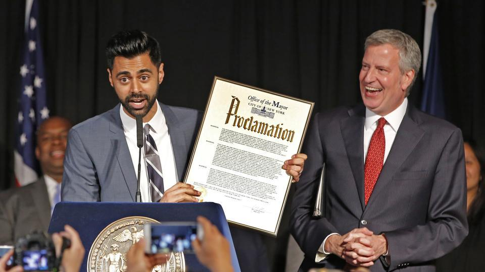 New York Mayor Bill de Blasio, right, reacts as comedian Hasan Minhaj speaks during the Asian-Pacific Heritage reception at Gracie Mansion in New York on Wednesday, May 10, 2017. De Blasio honored Minhaj at the reception, who recently performed at the White House Correspondents Dinner.
