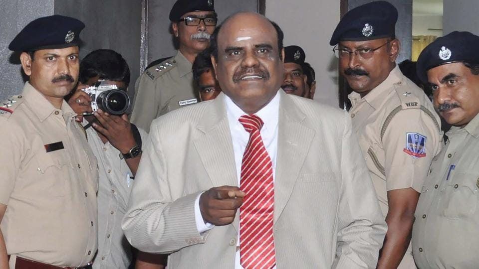 Calcutta high court judge Justice Karnan gestures as he speaks with Indian police personnel in Kolkata on May 4.