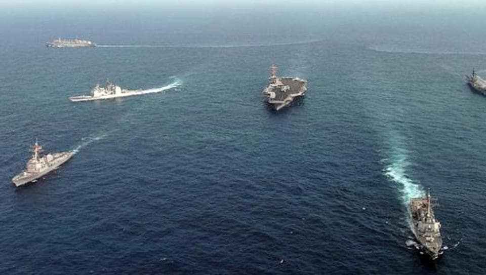 Ships assigned to the USS Nimitz(C) Carrier Strike Group and the Indian aircraft carrier Viraat(2nd-R) underway in the Indian Ocean 25 September, 2005 in formation as part of exercise