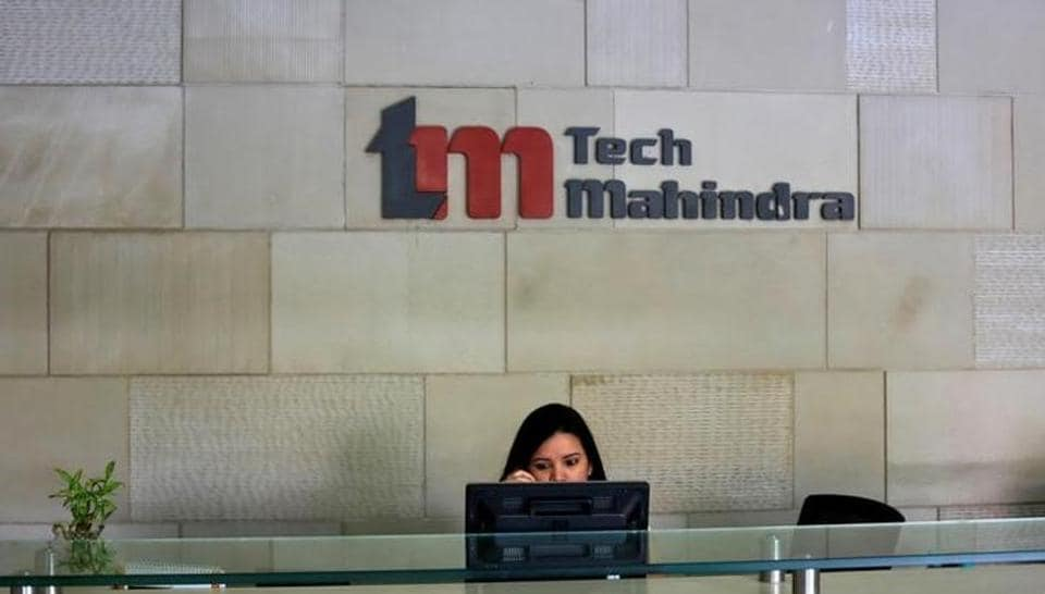 An employee at the front desk in the Tech Mahindra office in Noida near New Delhi.