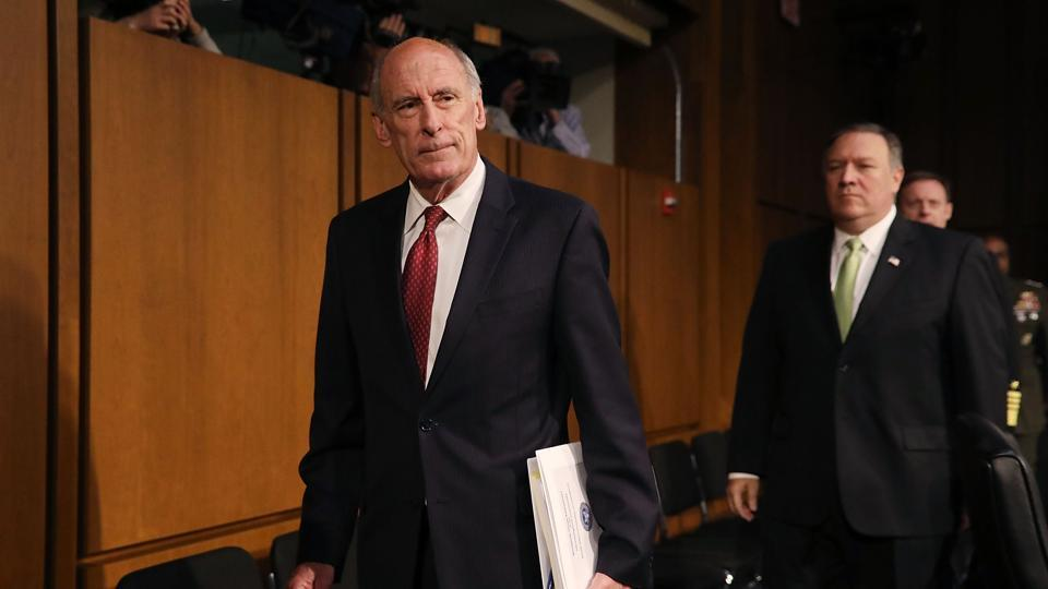 Director of US National Intelligence Dan Coats (L) and Central Intelligence Agency director Mike Pompeo arrive before testifying to the Senate Intelligence Committee in Washington, DC on Thursday.