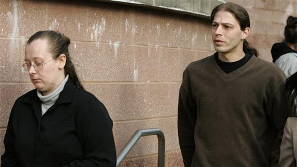 In this March 12, 2009 file photograph, Isidore Heath Campbell (right), and his wife, Deborah, leave a justice centre in New Jersey after a court hearing.