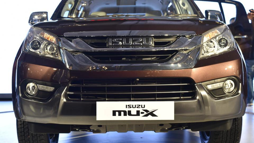 The MU-X gets V-Cross-like face with two big chrome slats on the grille holding the emblem. Some may like it, but for others, the faces of Fortuner and Endeavour might still have an edge over the MU-X's styling. (Vipin Kumar/HT PHOTO)