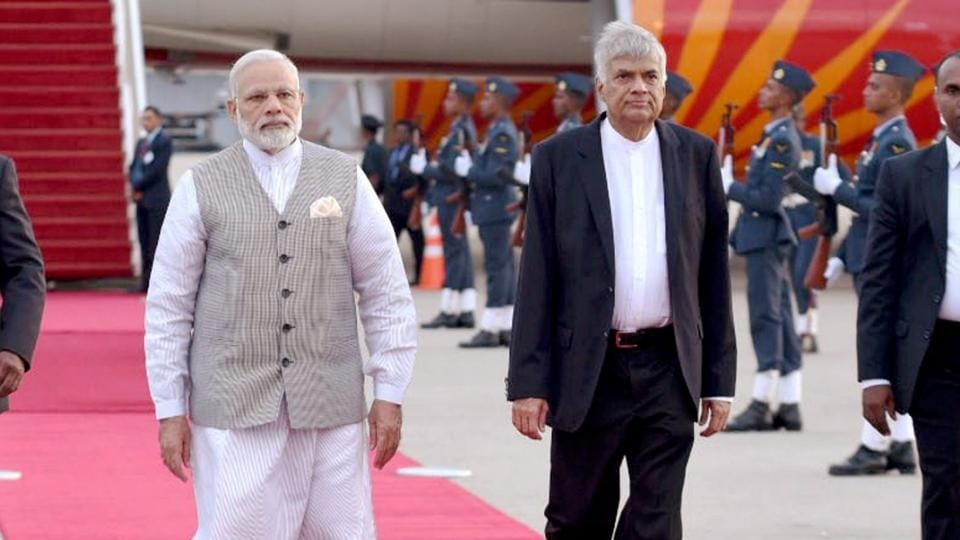 Prime Minister Narendra Modi being received by Sri Lankan Prime Minister Ranil Wickremesinghe upon his arrival at Bandaranaike International Airport in Colombo on Thursday.