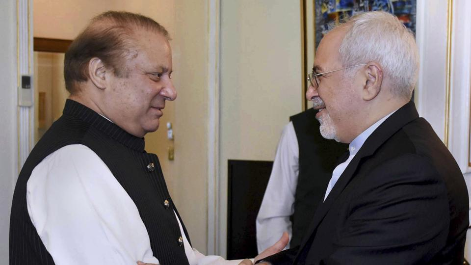 IIranian Foreign Minister Mohammad Javad Zarif with Pakistani Prime Minister Nawaz Sharif  (left)meeting in Islamabad,  May 3. Pakistan said Wednesday it has reached an agreement with Iran to strengthen security along their shared border following last week's incident in which gunmen killed 10 Iranian border guards.