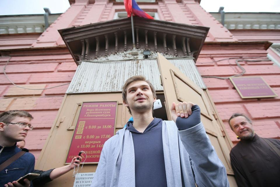 Ruslan Sokolovsky leaves his hearing at a court in Yekaterinburg on Thursday.