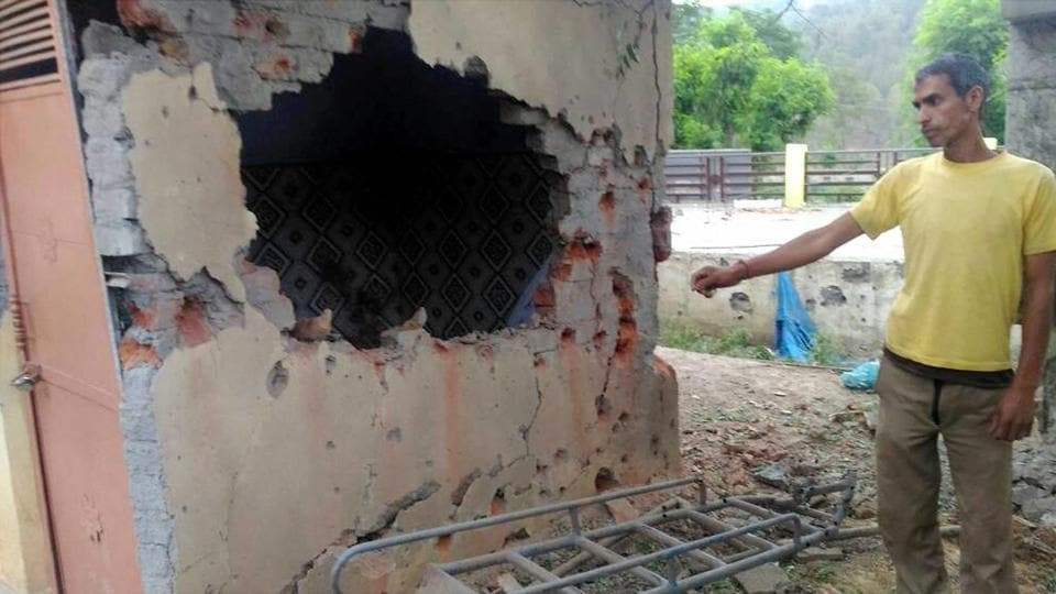A man points at the damage caused to a government school in Jhangar area due to heavy shelling by Pakistani troops on Wednesday night.