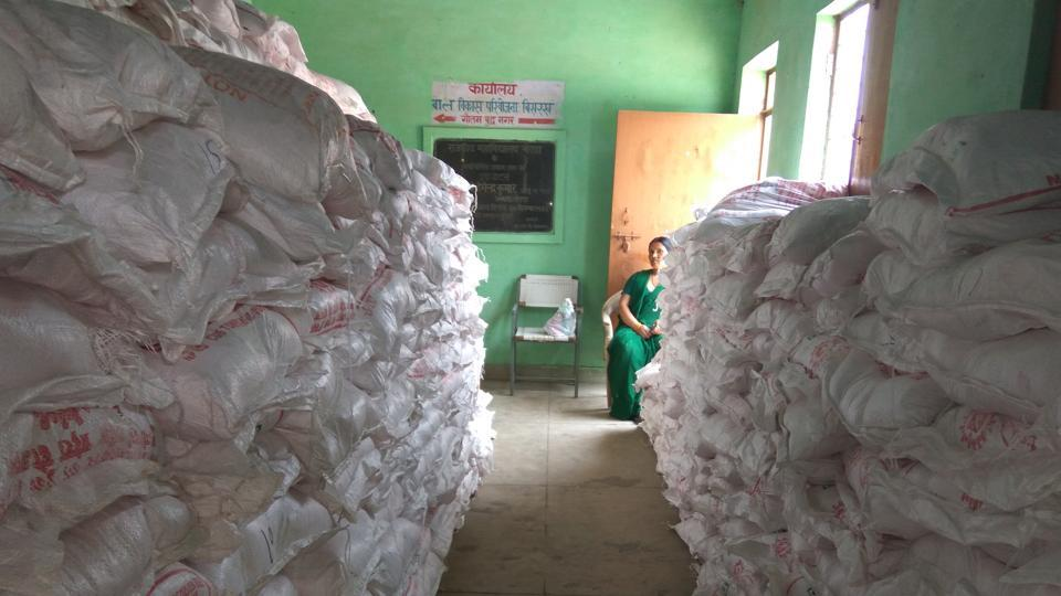 Bisrakh ICDS office packed with supplementary food bags.