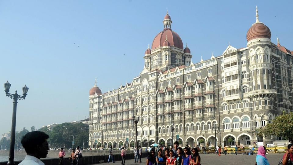 Tourists take photographs outside the iconic Taj Mahal Palace and Hotel - one of the sites of the 2008 terror attacks in Mumbai.