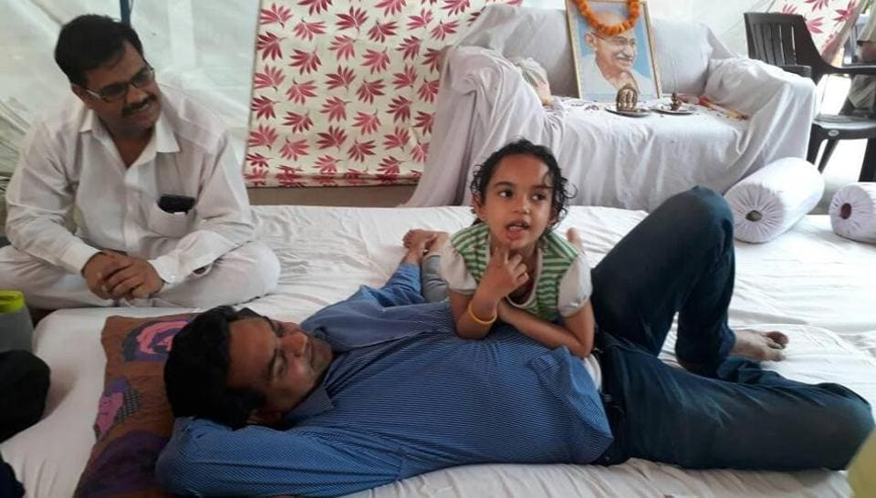 Sacked AAP minister Kapil Mishra with his daughter Pihu, as his hunger strike entered the third day on Friday.  Mishra has asked AAP convener Arvind Kejriwal to reveal details of foreign trips undertaken by the party leaders.