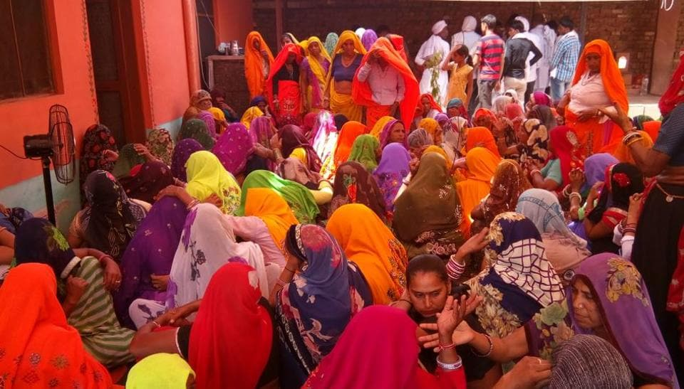 Women mourn at a victim's house in Sewar, Bharatpur, on Friday.
