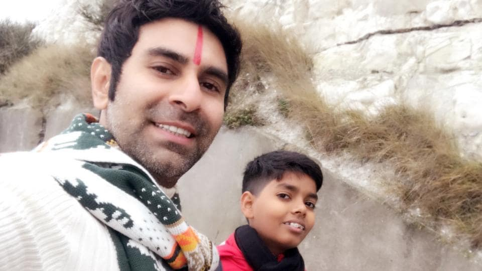Sandip Soparrkar with his 12-year-old son Arjun, whom he adopted 10 years ago.