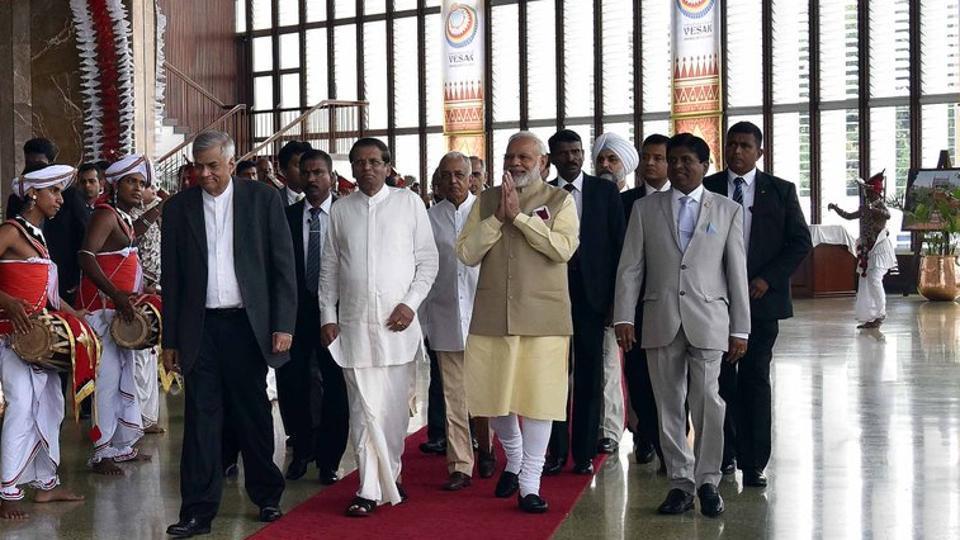 Prime Minister Narendra Modi, Sri Lankan President Maithripala Sirisena (in white) and Prime Minister Ranil Wickremesinghe (in black suit) at the the 14th International Vesak Day celebrations in Colombo on Friday.