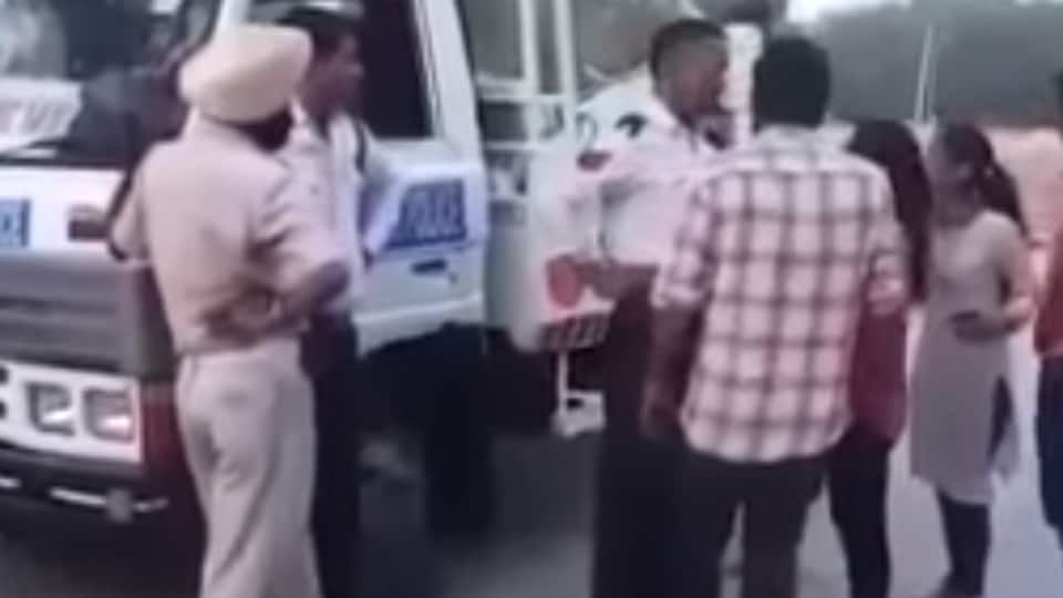 A woman assaulting a cop on being apprehended for jumping traffic signal in Sector 43. The video had gone viral after the incident on Monday evening.