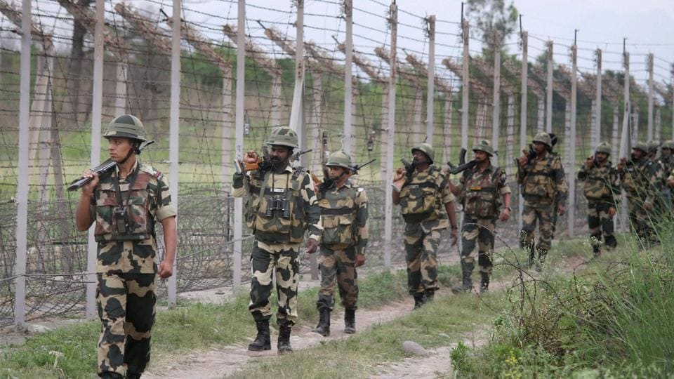 BSF personnel patrol along the international border on the outskirts of Jammu.