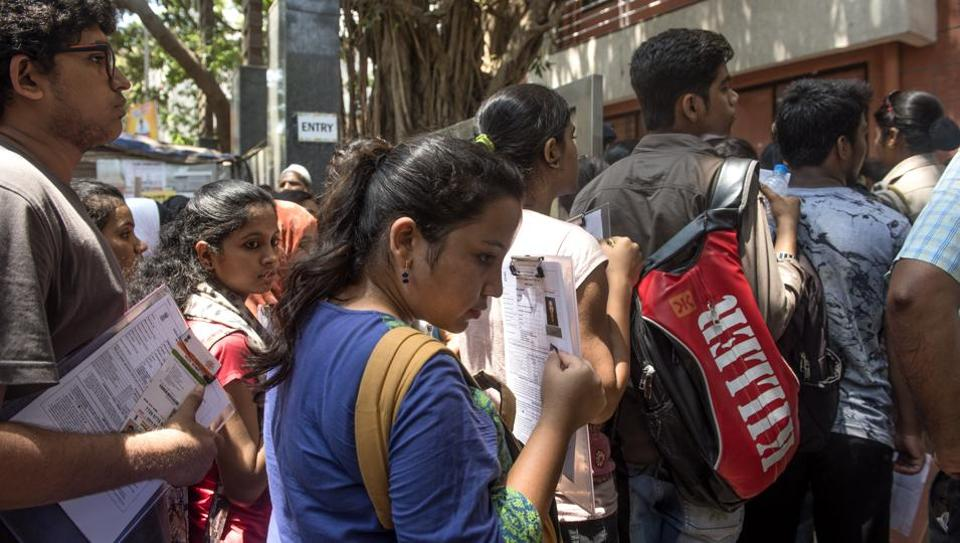 Students line up outie one of the MH-CET centres in Mumbai  on Thursday.