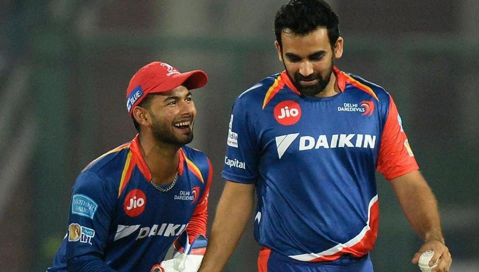 Zaheer Khan (R) celebrates with teammate wicketkeeper Rishab Pant (L) after the dismissal of Rising Pune Supergiant batsman Ajinkya Rahane in an 2017 Indian Premier League (IPL) match.