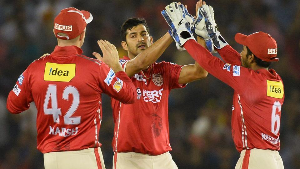 Kings Xi Punjab bowler Mohit Sharma (C) celebrates with his teammates after their victory over Mumbai Indians in the IPL 2017.