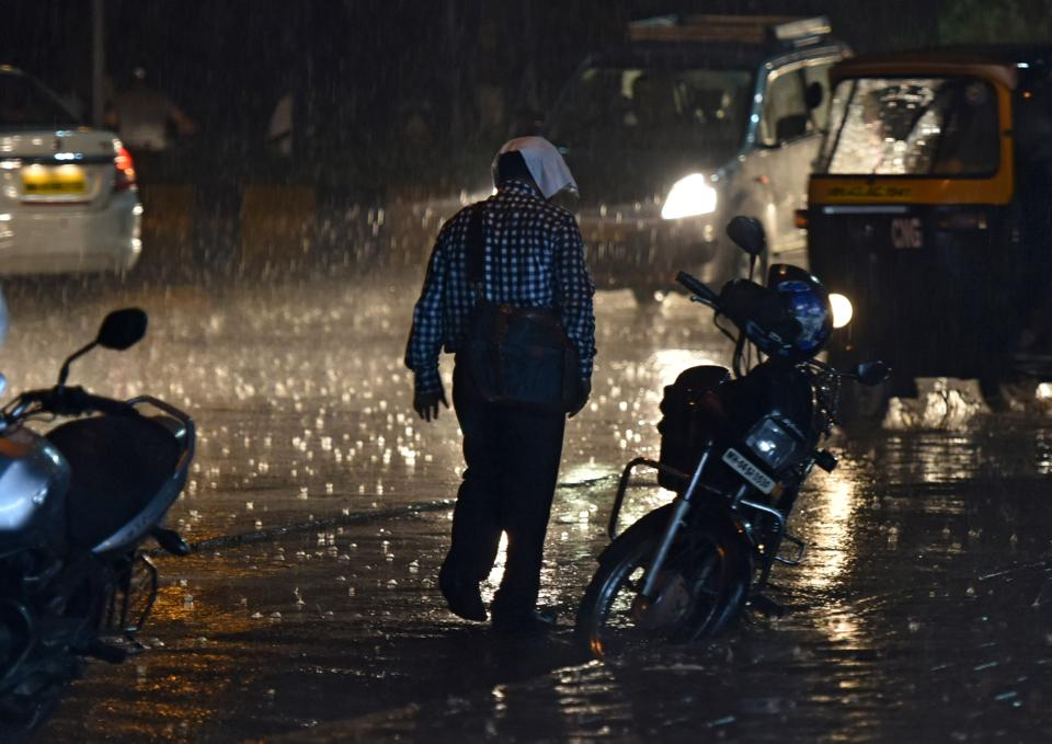 A man is caught unawares in the rain at Navi Mumbai.
