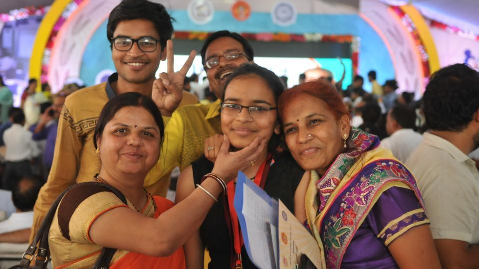 Family members of a topper celebrating during felicitation function of the meritorious students of the MP state board examinations in Bhopal on Friday.