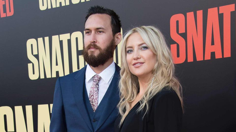 Danny Fujikawa (L) and Kate Hudson at the world premiere of Snatched in Westwood, California, USA.
