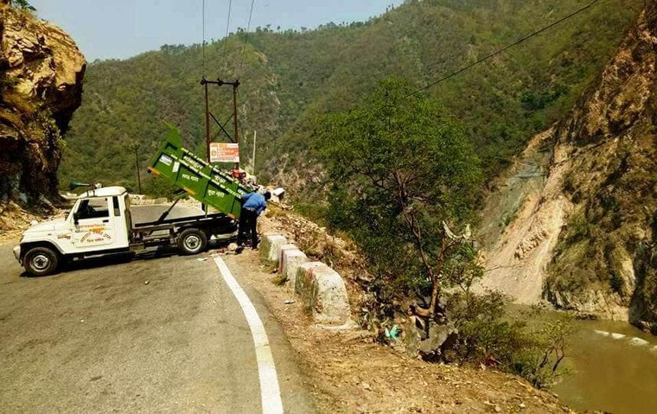 Garbage being dumped down a slope along the Alaknanda River, a tributary of the Ganga, at Rudraprayag in Uttarakhand.