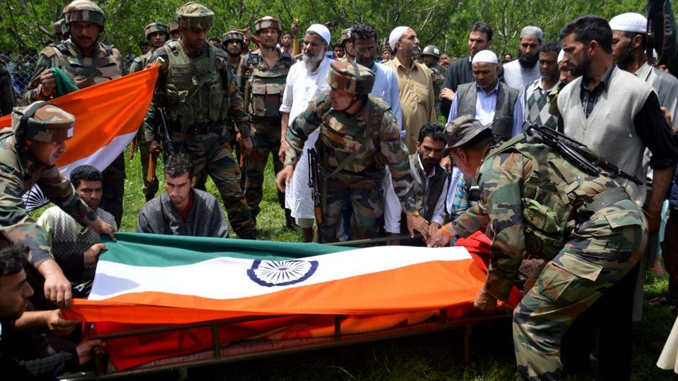 Indian Army personnel attend the funeral of Lt Ummer Fayaz, who was killed in Shopian district of Kashmir.
