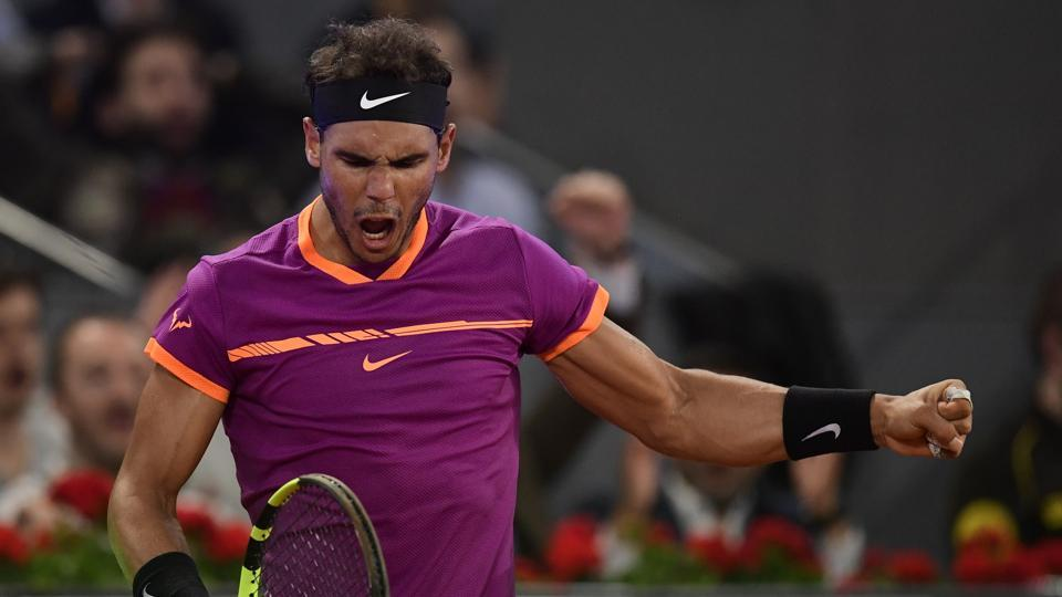 Rafael Nadal celebrates after winning a point against David Goffin in a Madrid Open quarter-final.