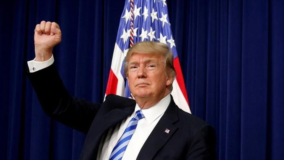 US President Donald Trump pumps his fist as he departs after attending a CEO town hall on the American business climate at the Eisenhower Executive Office Building in Washington.