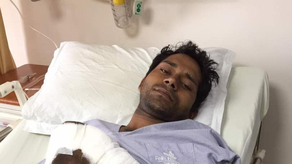 Security guard Anil SIngh in hospital after losing three fingers in the attack in which his hand was shoved into a fodder machine outside Greater Noida.