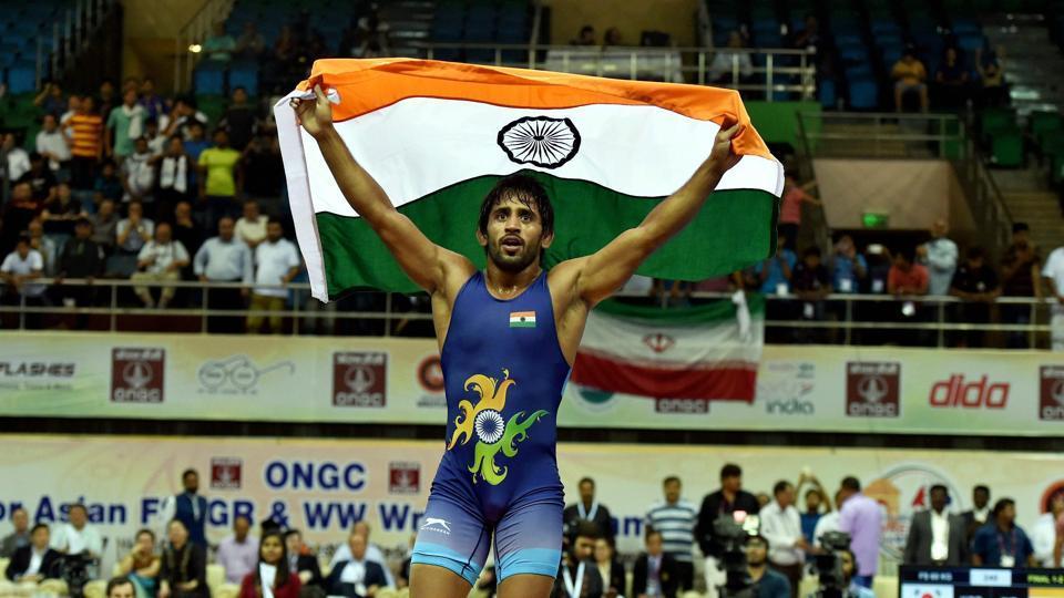 Indian wrestler Bajrang Punia celebrates after winning gold at Asian Wrestling Championship at I G Stadium in New Delhi on Saturday.