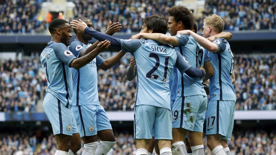 Manchester City's David Silva (centre) celebrates scoring during the Premier League  match against Leicester City.