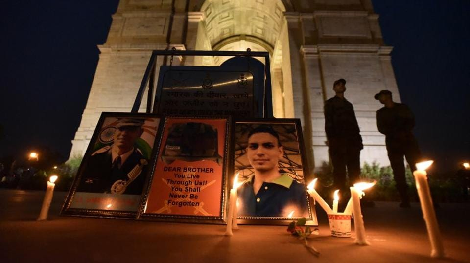 People pay homage to Lieutenant Ummer Fayaz at India Gate in New Delhi on Saturday.