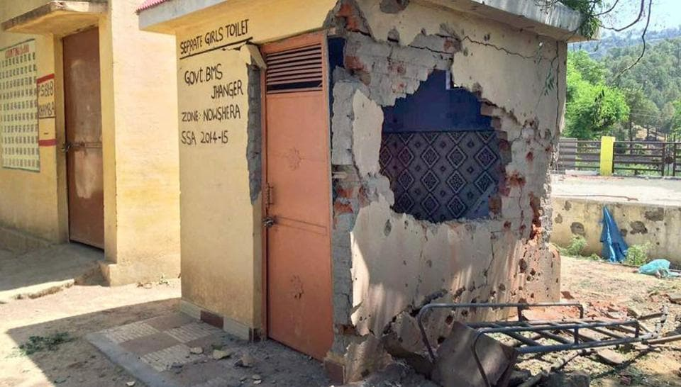 The damaged wall of a government school, which was hit by mortal shells in Nowshera sector of Rajouri district on Thursday.