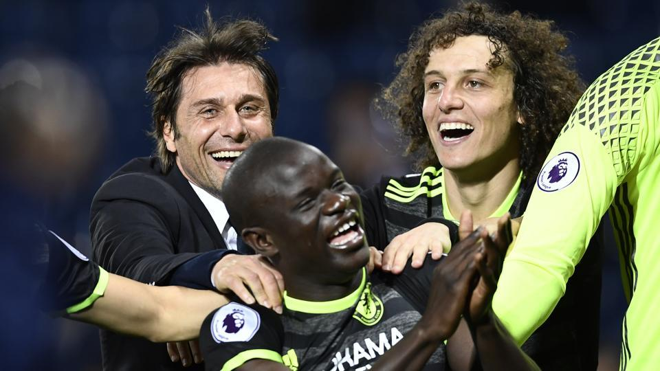Chelsea Football Club manager Antonio Conte celebrates with David Luiz and N'Golo Kante after winning the English Premier League title following a 1-0 win away at West Bromwich Albion on Friday.