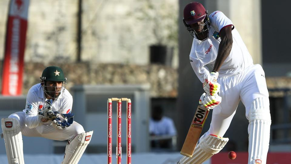 West Indies cricket team batsman Jason Holder hits a six as Pakistan cricket team wicketkeeper Sarfraz Ahmed looks on during Day 3 of the third and final Test at the Windsor Park Stadium in Roseau, Dominica, on Friday. Get cricket score of West Indies vs Pakistan 3rd Test, Day 3, here.