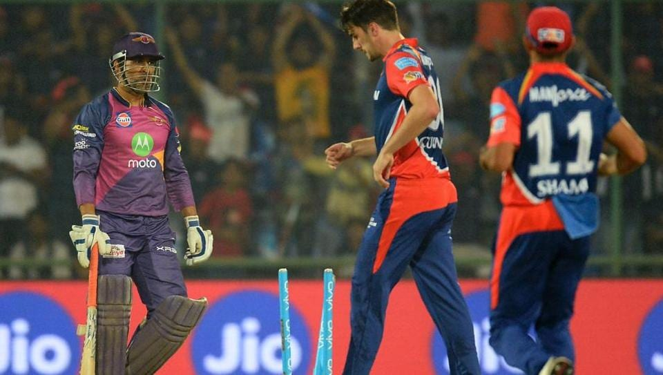Rising Pune Supergiant batsman MS Dhoni (L) walks back to the dugout after being run out by Delhi Daredevils pacer Mohammed Shami's (not in picture) direct hit in their Indian Premier League match in New Delhi on Friday.