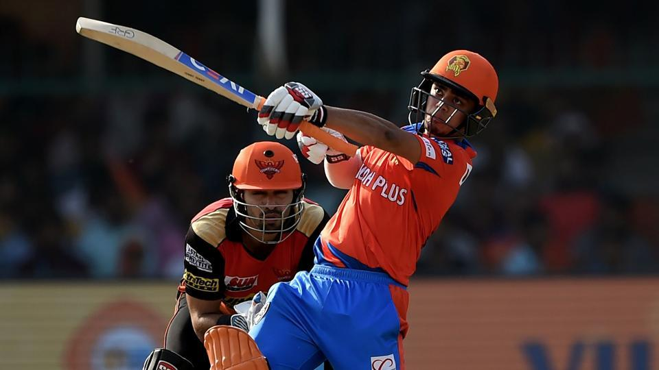 Gujarat Lions' Ishan Kishan (R) plays a shot during his innings against Sunrisers Hyderabad in the 2017 Indian Premier League (IPL) T20 match against Sunrisers Hyderabad at the Green Park Stadium in Kanpur.