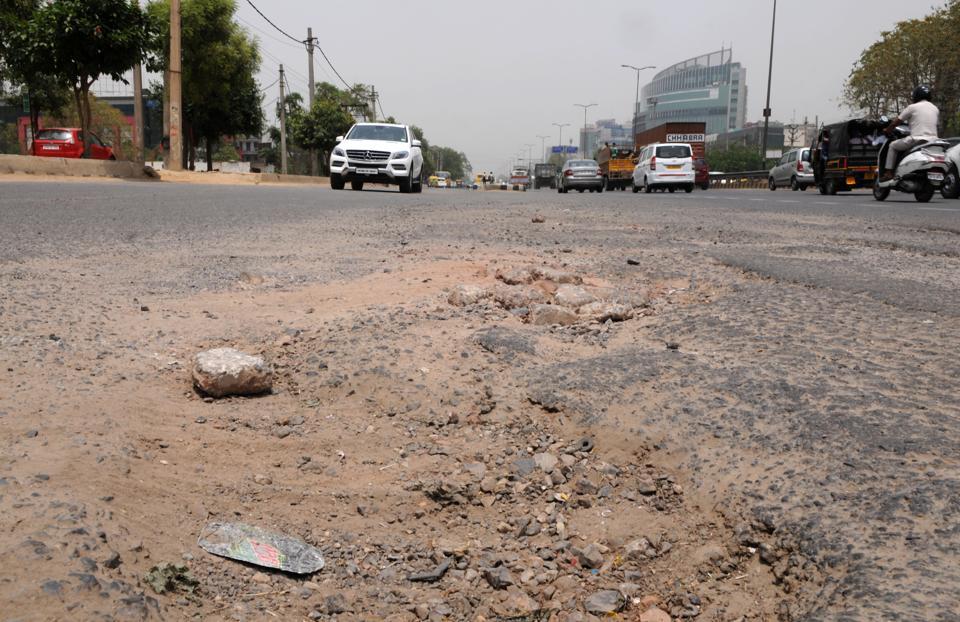 One meter deep pothole,Sohna Road,Vipul Trade centre