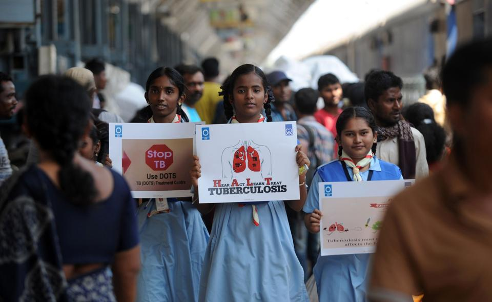 Schoolchildren hold placards as they participate in a tuberculosis awareness campaign at a railway station in Chennai on World Tuberculosis Day.  In India, undernutrition contributes to a staggering 55% of the annual TB incidence.