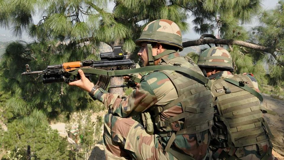 Indian Army jawans take position near the Line of Control in Nowshera sector.