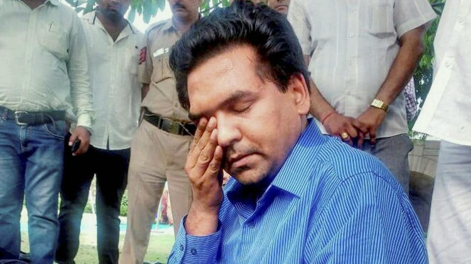 Sacked AAP minister Kapil Mishra breaks down during his visit at Rajghat as he continues his hunger strike on the third day in New Delhi on Friday.