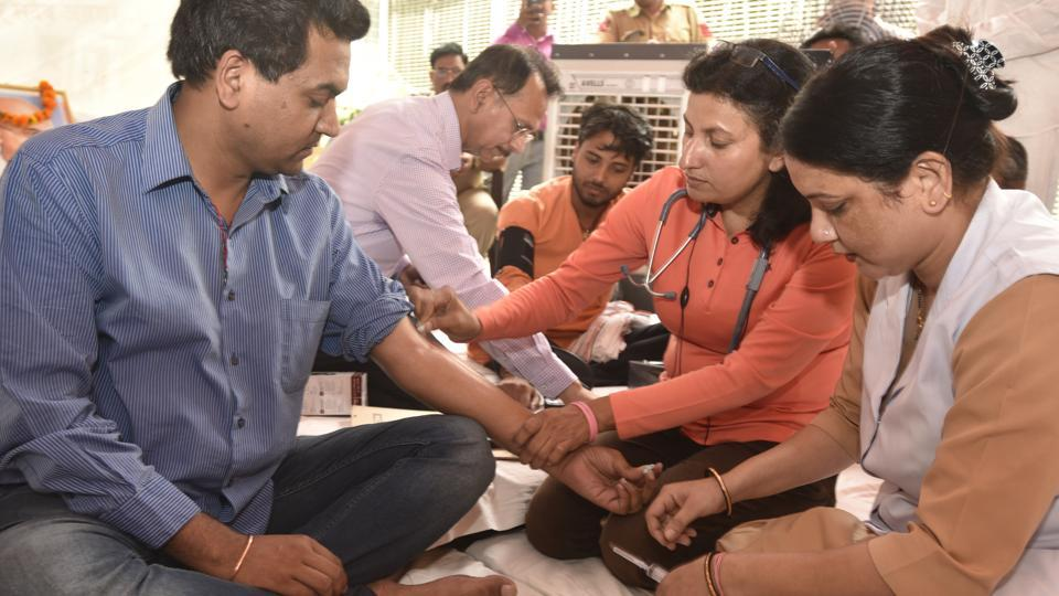 Aam Aadmi Party leader Kapil Mishra being checked by doctors at his residence on his third day of hunger strike in New Delhi on May 12, 2017.