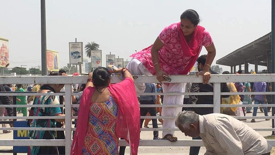 Customers gatecrashing the Metro Cash and Carry store in Ludhiana on Saturday, May 13.