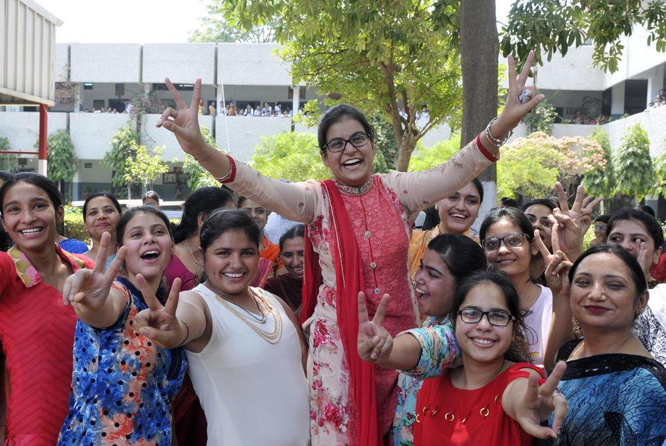Amisha Arora , who bagged the first position in the state by securing 98.44% marks in the Senior Secondary Examination (Class 12) conducted by the Punjab School Education Board (PSEB), celebrates with friends and family at RS Model Senior Secondary School, Ludhiana.