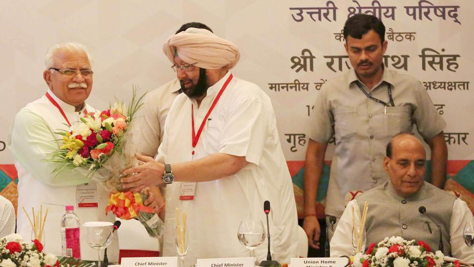 Haryana chief minister Manohar Lal Khattar, his Punjab counterpart Capt Amarinder Singh and Union home minister Rajnath Singh in Chandigarh on Friday.